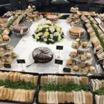 Funeral catering, showing a range of sandwiches and cakes
